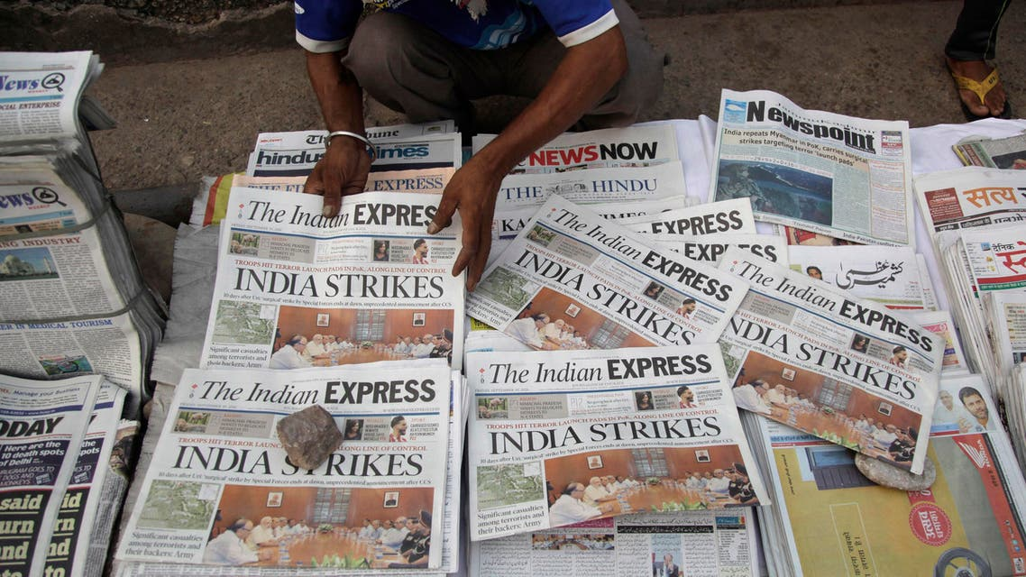 A newspaper vendor arranges morning newspapers carrying headlines of India's military strikes, in Jammu, India, Friday, Sept. 30, 2016. (AP)