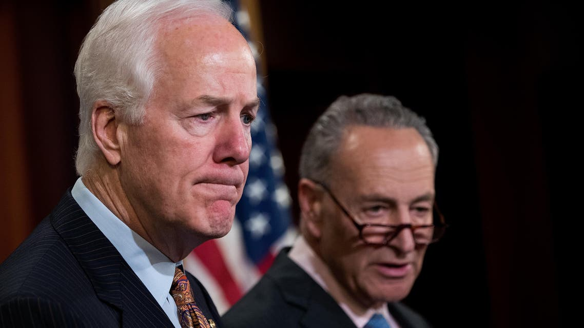 L to R, Sen. John Cornyn (R-TX) and Sen. Chuck Schumer (D-NY) take questions during a news conference concerning the Justice Against Sponsors of Terrorism Act (JASTA), on Capitol Hill, May 17, 2016, in Washington, DC. (AFP)
