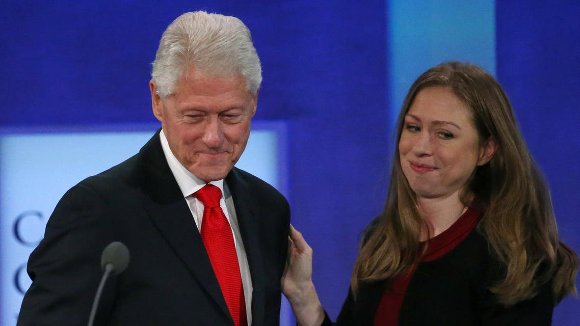 Former U.S. President Bill Clinton takes the stage as his daughter Chelsea Clinton embraces during the closing session of the Clinton Global Initiative 2016 (CGI) in New York, U.S., September 21, 2016. REUTERS/Shannon Stapleton