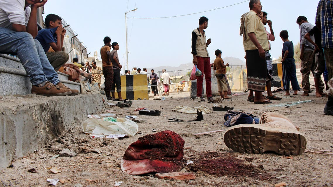 People gather at the scene after a pair of suicide bombings attack in the southern city of Aden, Yemen, Monday, May 23, 2016. (AP)
