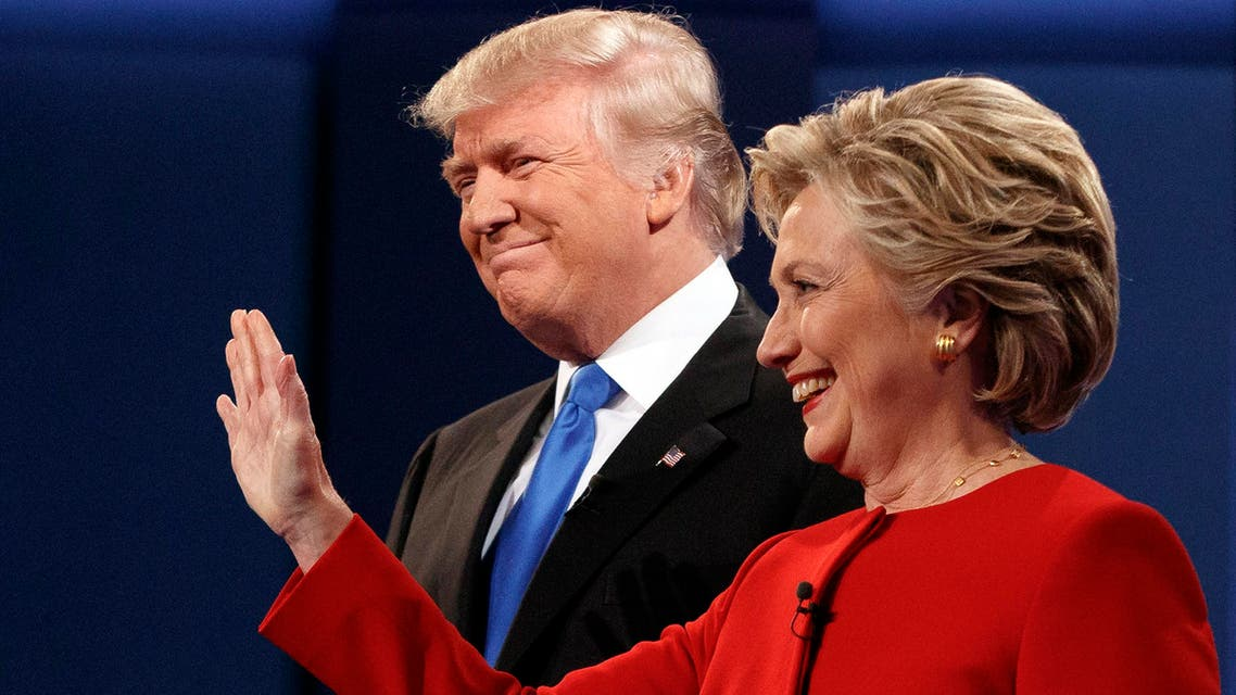 Republican presidential candidate Donald Trump, left, stands with Democratic presidential candidate Hillary Clinton at the first presidential debate at Hofstra University, Monday, Sept. 26, 2016, in Hempstead, N.Y. (AP)