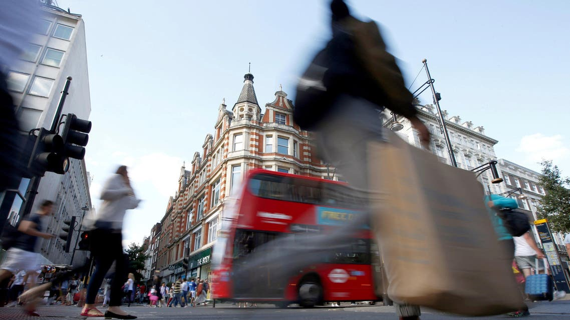 Shoppers cross the road in Oxford Street, in London, Britain August 14, 2016. Reuters