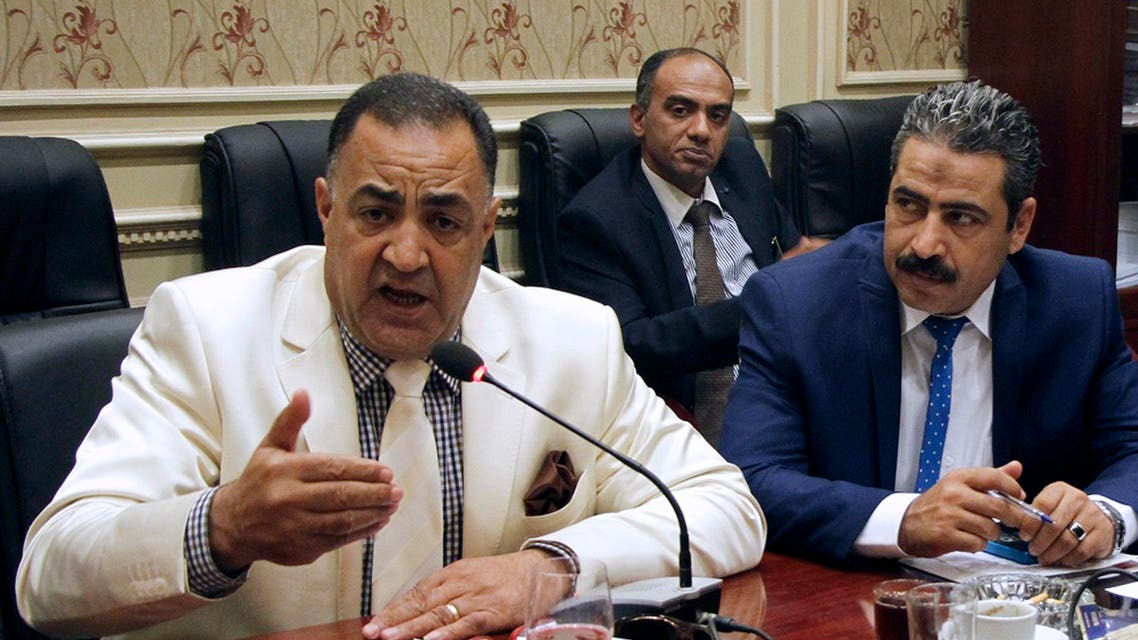 In this Sept. 8, 2016, photo, Egyptian Parliamentary member Ilhami Agena, left, attends the human rights committee in Cairo, Egypt. AP