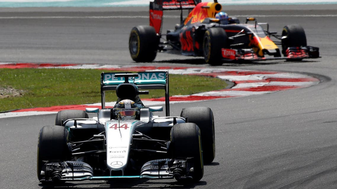 Mercedes' Lewis Hamilton of Britain leads Red Bull's Daniel Ricciardo of Australia during the race. REUTERS