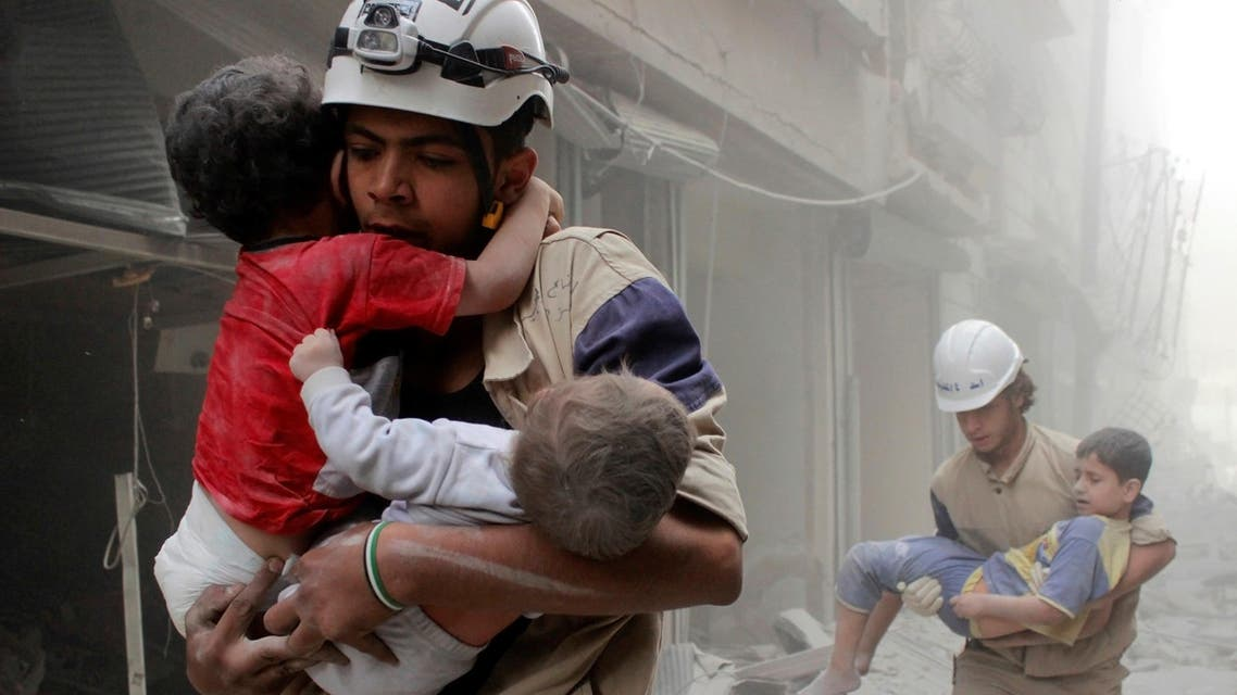 Members of the Civil Defence rescue children after what activists said was an air strike by forces loyal to Syria's President Bashar al-Assad in al-Shaar neighbourhood of Aleppo, Syria June 2, 2014. REUTERS