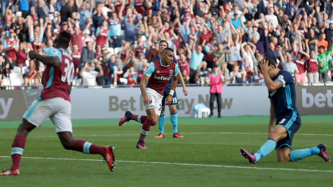 West Ham's Dimitri Payet, center, celebrates after scoring during the English Premier League soccer match between West Ham and Middlesbrough at The London Stadium in London, Saturday, Oct. 1, 2016.(AP)