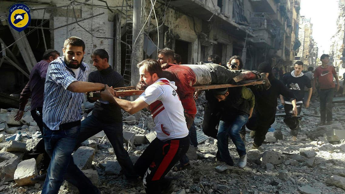 In this photo provided by the Syrian Civil Defense group known as the White Helmets, Syrians carry a victim after airstrikes by government helicopters on the rebel-held Aleppo neighborhood of Mashhad, Syria, Tuesday Sept. 27, 2016. (AP)