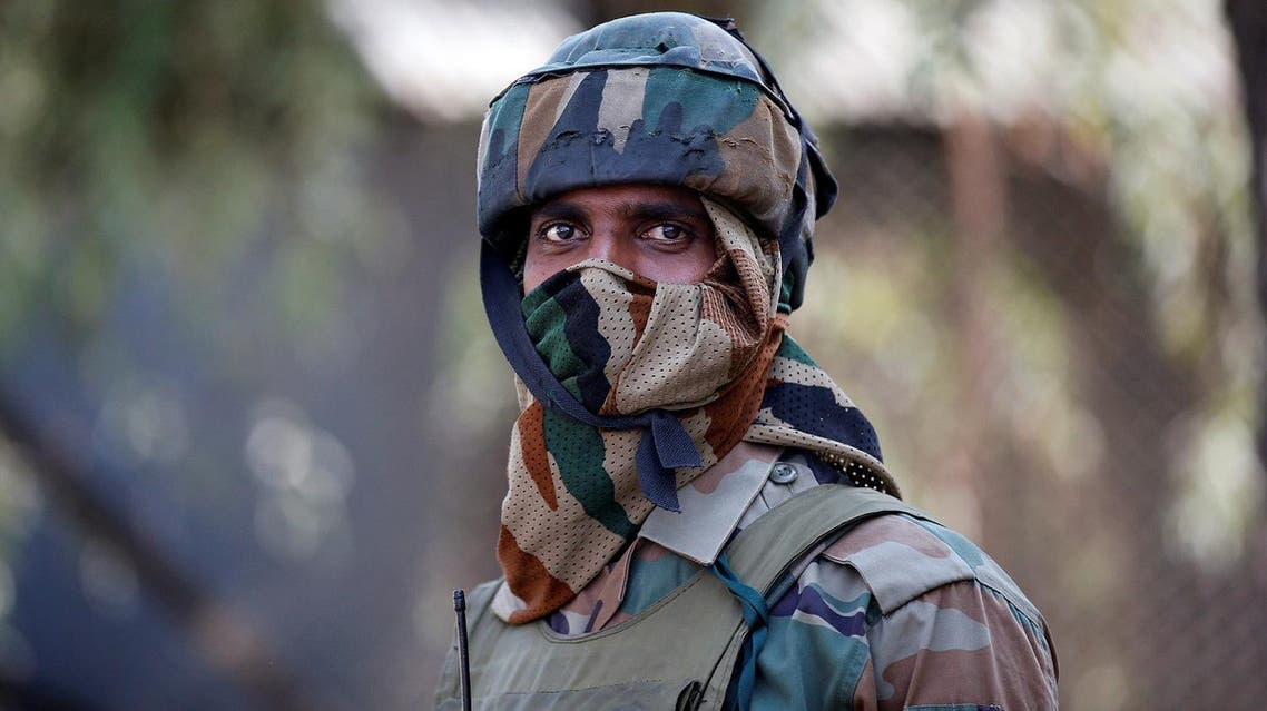 An Indian army soldier stands guard on a road on the outskirts of Srinagar. (Reuters)