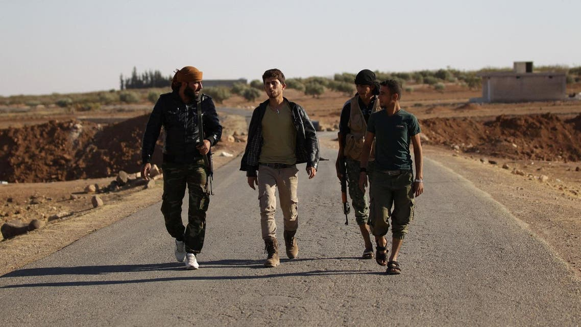 Rebel fighters of 'Al-Sultan Murad' brigade walk along a street on the outskirts of the northern Syrian town of Shawa. (Reuters)