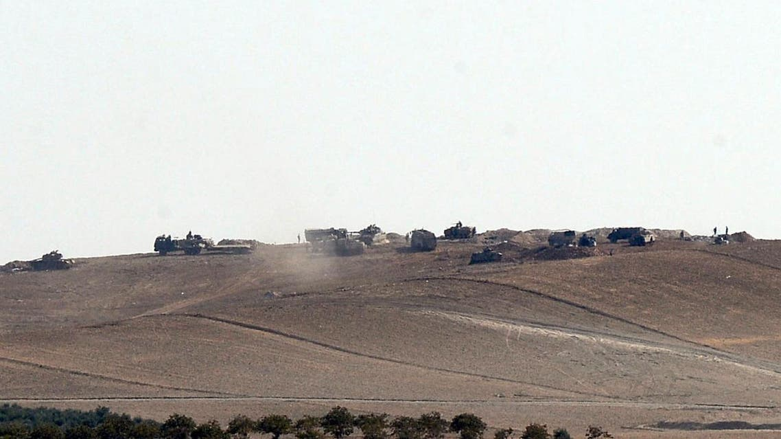 Turkish tanks and artillery are stationed near the Syrian border, in Karkamis, Turkey, Monday, Aug. 29, 2016. AP
