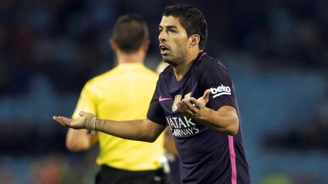 FC Barcelona's Luis Suarez reacts against Celta Vigo . REUTERS