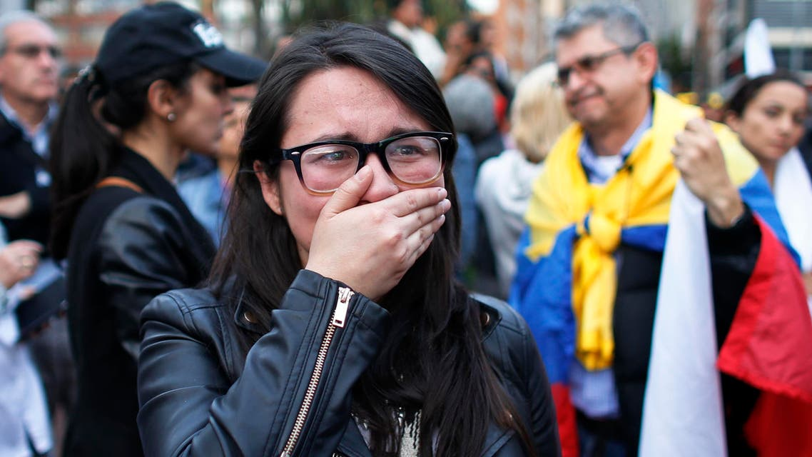 A supporters of the peace accord signed between the Colombian government and rebels of the Revolutionary Armed Forces of Colombia, FARC, cries as she follows on a giant screen the results of a referendum to decide whether or not to support the deal in Bogota, Colombia, Sunday, Oct. 2, 2016. (AP)