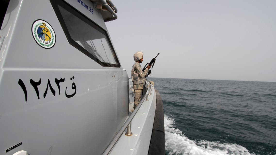 A Saudi border guard watches as he stands in a boat off the coast of the Red Sea on Saudi Arabia's maritime border with Yemen, near Jizan April 8, 2015. Iran sent two warships to the Gulf of Aden on Wednesday, state media reported, establishing a military presence off the coast of Yemen where Saudi Arabia is leading a bombing campaign to oust the Iran-allied Houthi movement. REUTERS