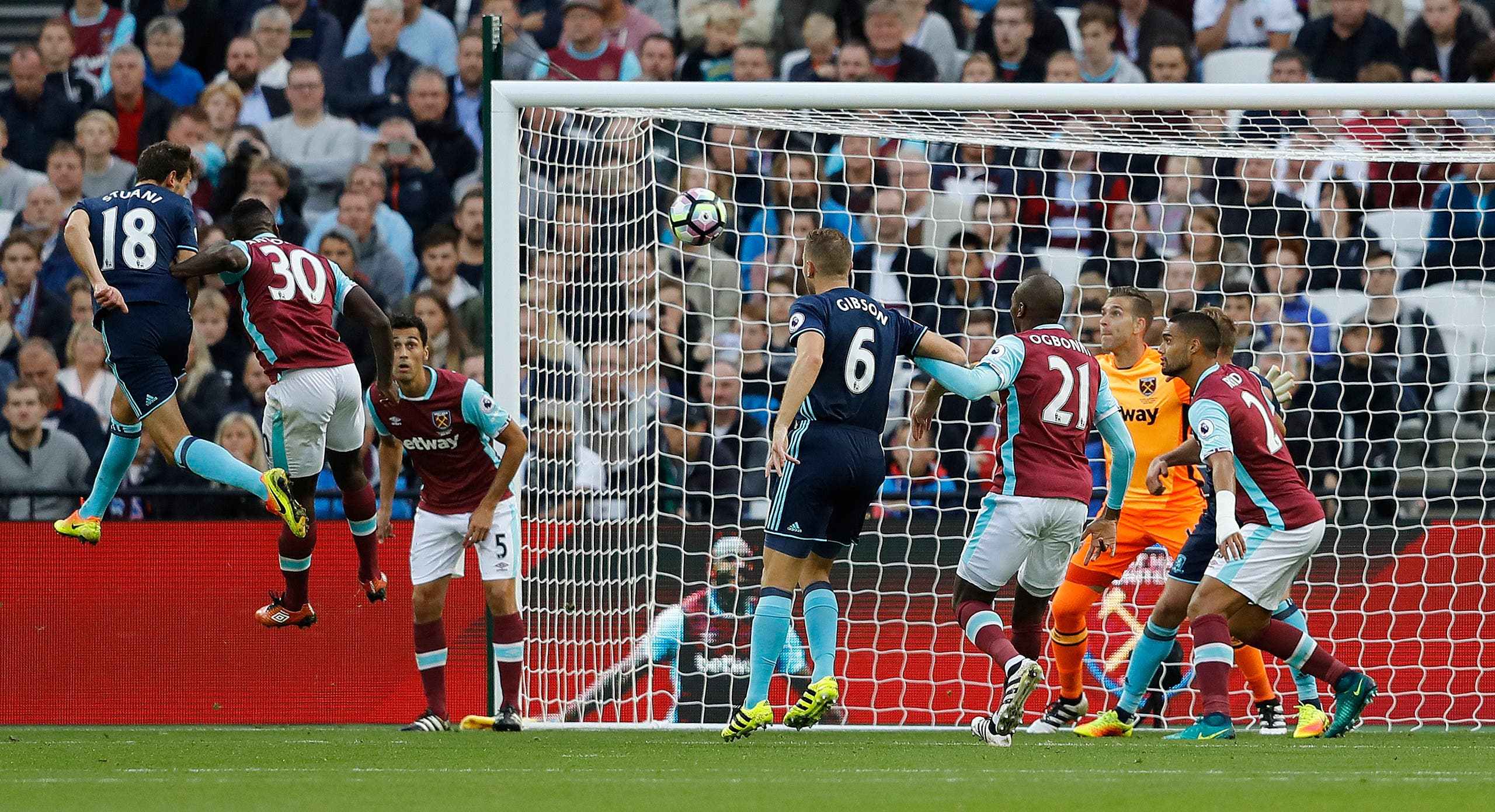 Middlesbrough's Cristhian Stuani, left, heads to score during the English Premier League soccer match between West Ham and Middlesbrough at The London Stadium in London, Saturday, Oct. 1, 2016. (AP)