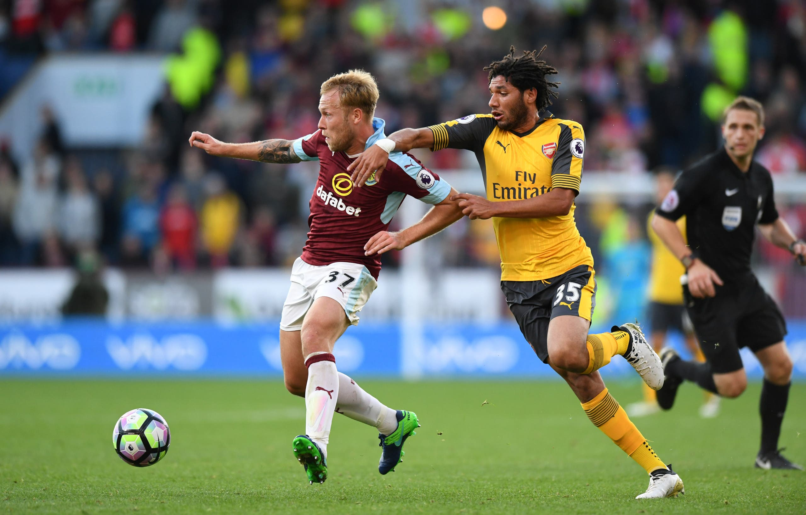 Burnley's Scott Arfield in action with Arsenal's Mohamed Elneny Reuters
