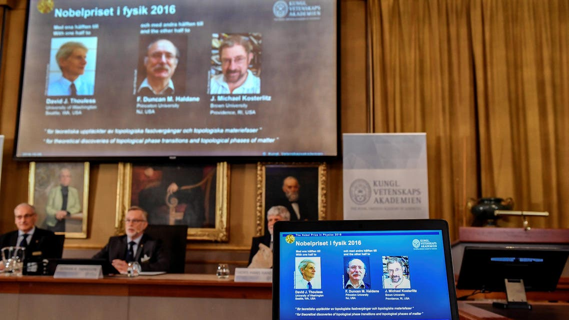 Members of the Royal Academy of Sciences, Nils Martensson (L-R), Goran K Hansson and Thomas Hans Hansson, announcing the winners of the 2016 Nobel Prize for Physics during a news conference in Stockholm. (Reuters)