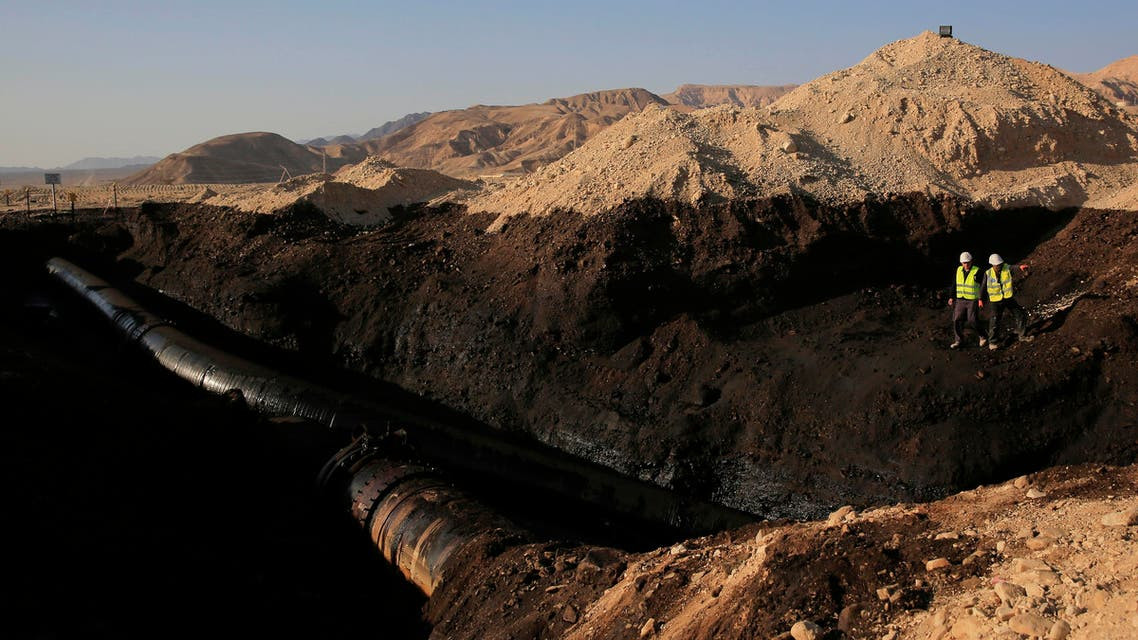 File photoof the Trans-Israel Pipeline clean up the large deposits of crude oil that gushed out of a breached pipeline near the village of Beer Ora, north of Eilat. AP