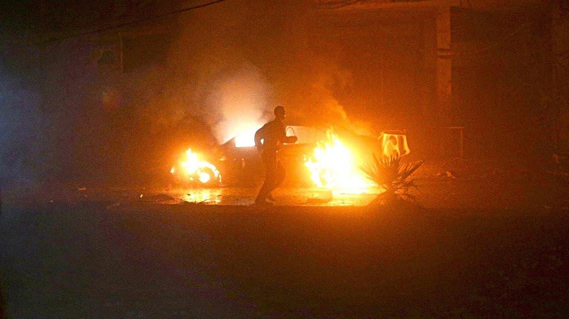 A man runs near a burning car after an airstrike in the rebel held Douma neighbourhood of Damascus. (Reuters)