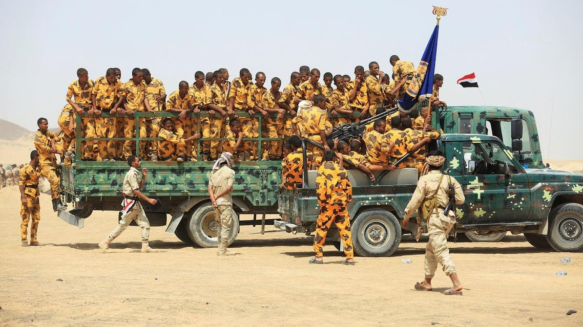 Pro-government soldiers march during a military parade celebrating the 54th anniversary of North Yemen's revolution in the central province of Marib. (Reuters)