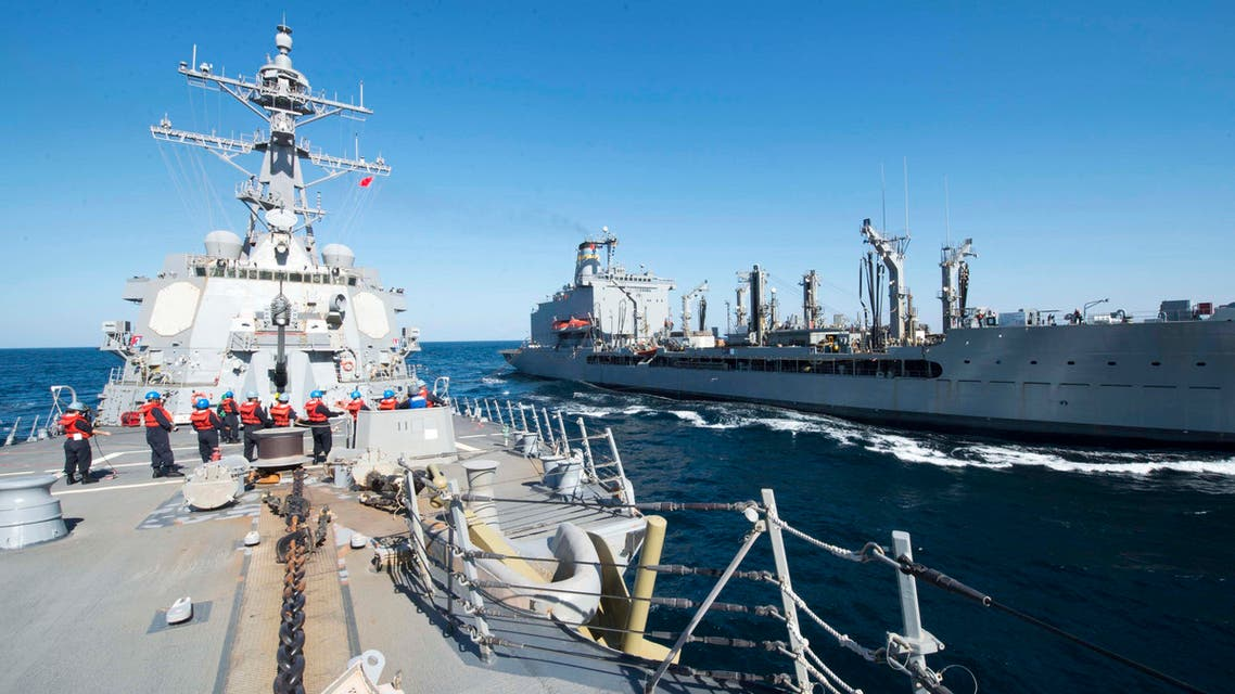In this Thursday, Dec. 24, 2015 photo released by the U.S. Navy, guided-missile destroyer USS Bulkeley participates in a replenishment-at-sea with fleet replenishment oiler USNS John Lenthall in the Gulf of Oman. (AP)