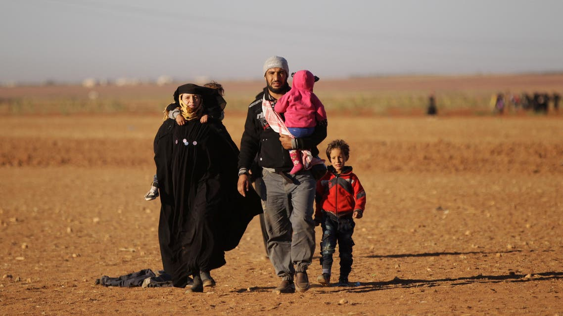 People who fled from Islamic State-controlled areas arrive in the northern Syrian rebel-held town of Waqf, near al-Rai town, in Aleppo Governorate, Syria, September 29, 2016. (AP)