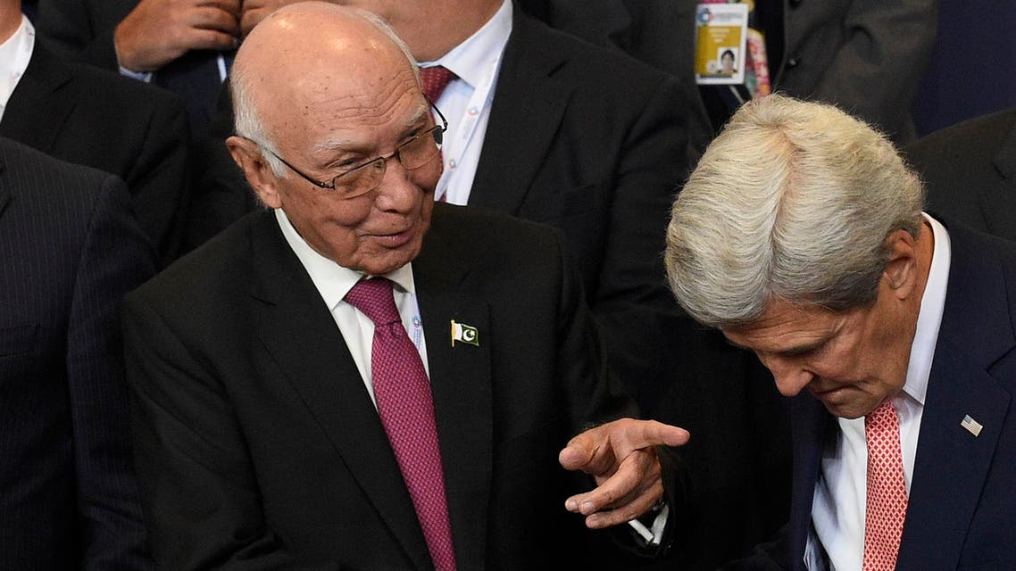 Pakistan Foreign Affairs minister Sartaj Aziz (L) shakes hands with US Secretary of State John Kerry (R) during a meeting on Afghanistan at the EU Headquarters in Brussels on October 5, 2016. (AFP)