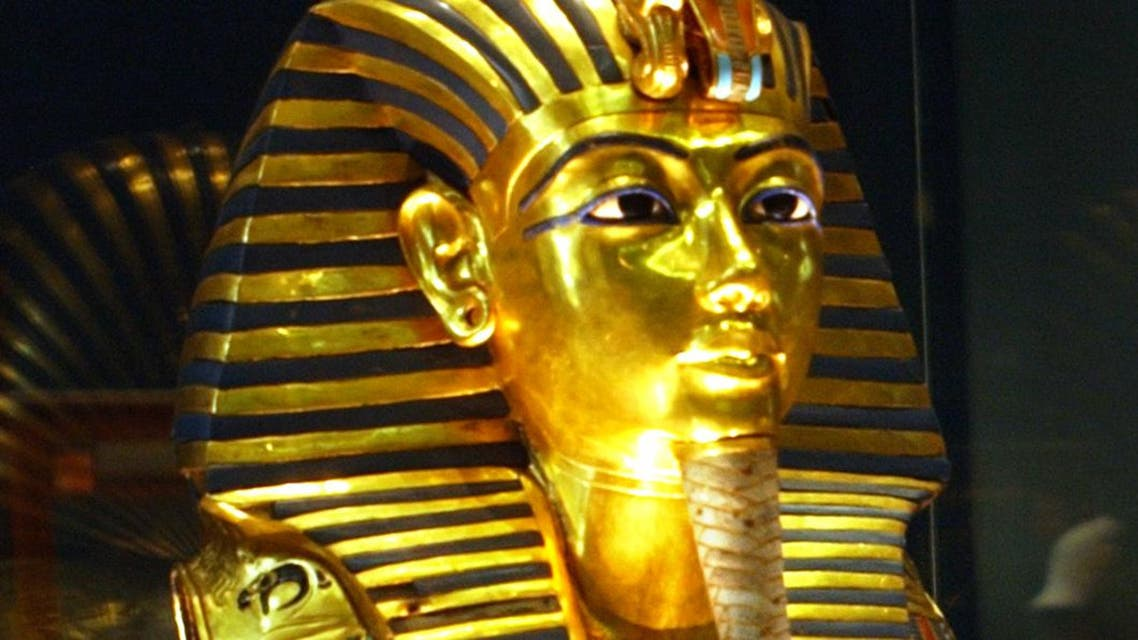 Tourists look to the gold mask of King Tutankhamun at the Egyptian museum in Cairo Wednesday, May 11, 2005. AP