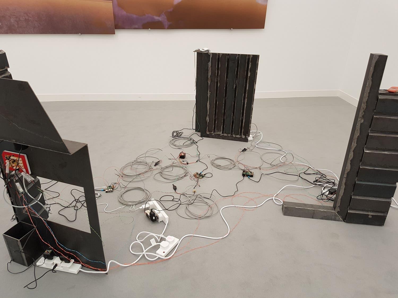 "Shadi Habib Allah's ""A Defective Wave Shields Disparate Topographies"" at the Green Art Gallery booth. (Saffiya Ansari/ Al Arabiya English)"