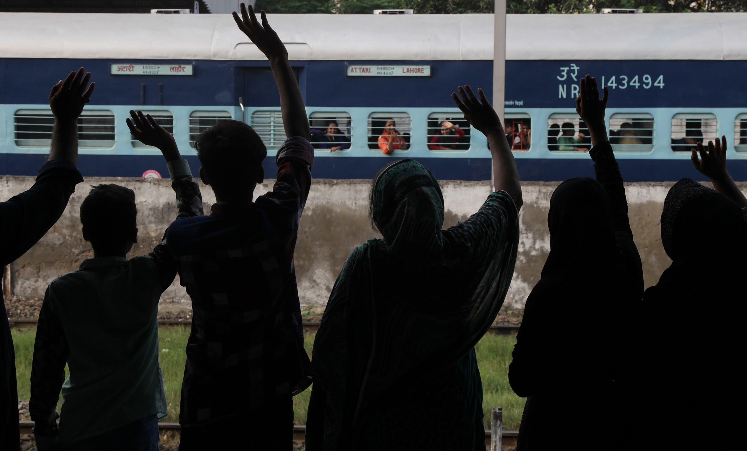 People see off passengers traveling to neighboring India at a railway station in Lahore, Pakistan, Monday, Sept. 26, 2016. AP