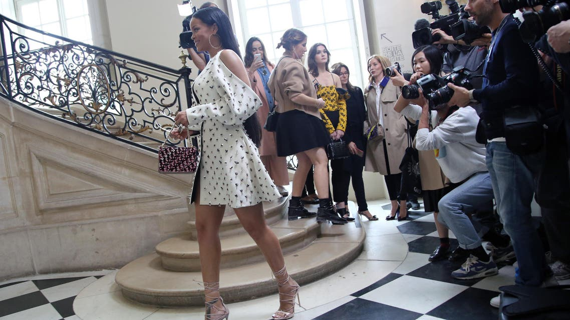 Singer Rihanna makes her way through reporters as she arrives to Christian Dior's Spring-Summer 2017 ready-to-wear fashion collection presented in Paris, Friday, Sept. 30, 2016. (AP)