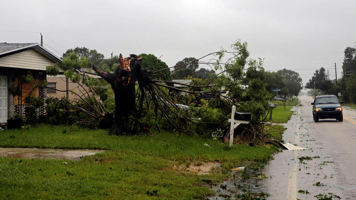 A fallen tree is seen outside a house after Hurricane Matthew hits in Melbourne, Florida, U.S., October 7, 2016. REUTERS/Henry Romero