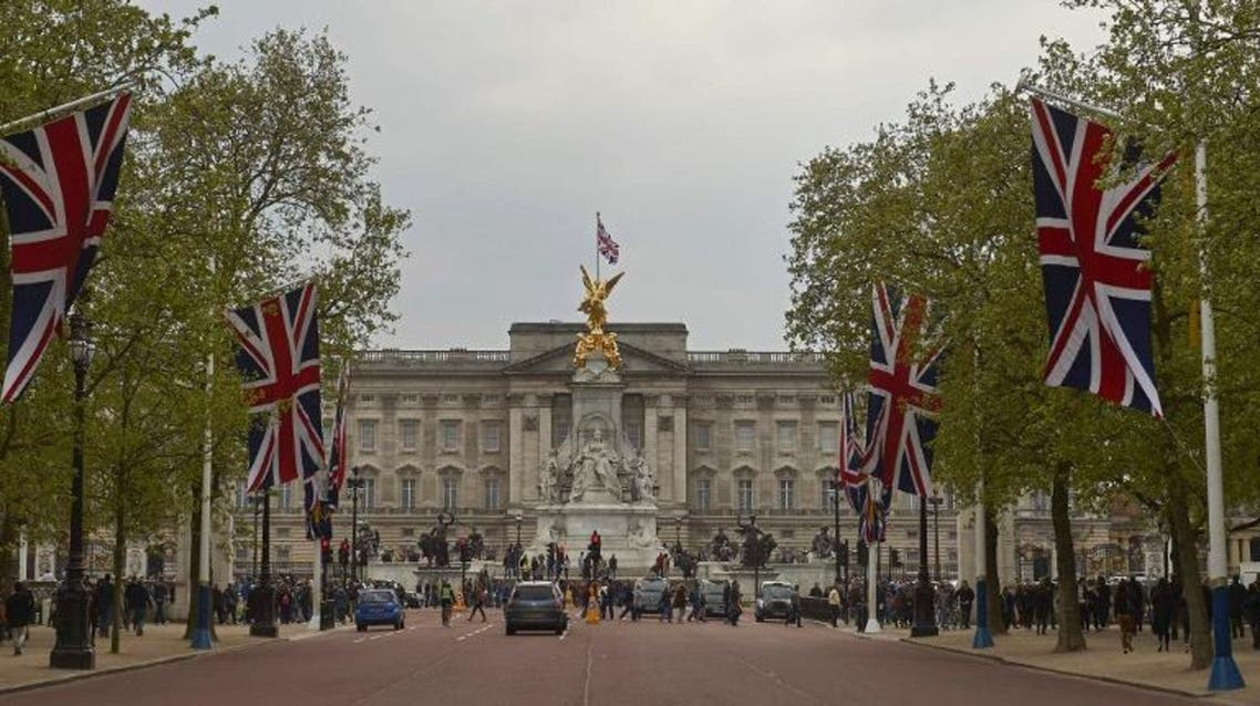 Britain's Union flags line the Mall leading to Buckingham Palace (Background) in central London on May 2, 2015. AFP