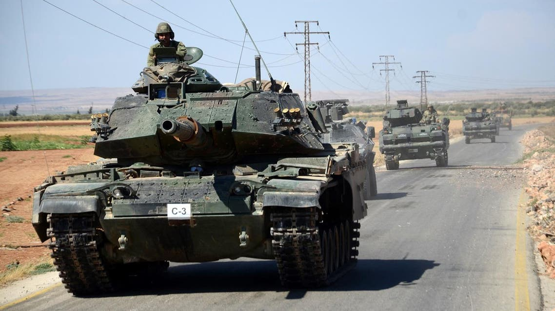 Turkish troops drive their tanks on September 4, 2016 on a road near the Syrian village of al-Waqf and some 3km south of al-Rai, the small border town with Turkey. (AFP)