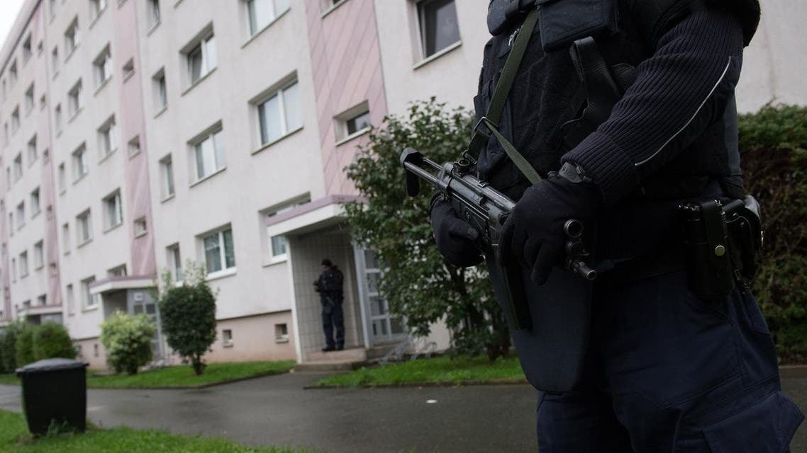 Police officers secure a residential area in Chemnitz, eastern Germany, Saturday Oct. 8,2016. German police have raided an apartment building in the eastern city of Chemnitz after receiving information someone may be planning a bombing attack. (Arno Burgi/dpa via AP)