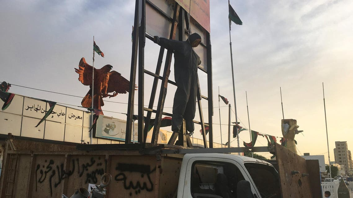 A scarecrow is seen on a scaffold used by Islamic State in Sirte to display bodies of executed prisoners, mounted on a would-be suicide bomber's captured truck, outside Misrata's museum, Libya September 29, 2016. Picture taken September 29, 2016. REUTERS