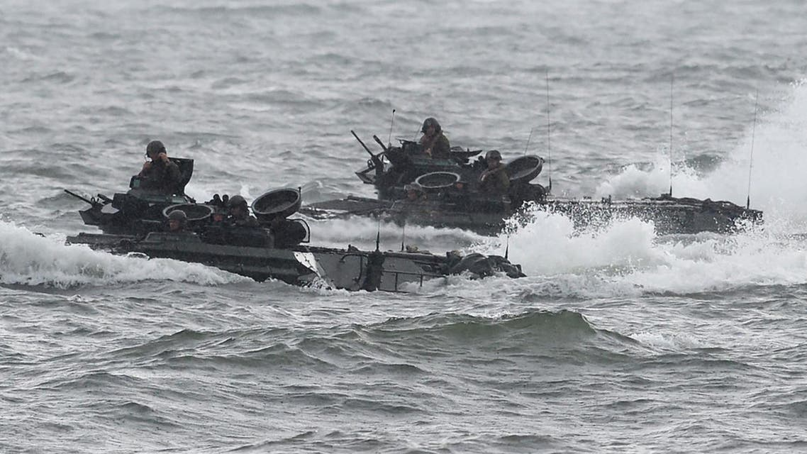 "US marines Amphibious Assault vehicles (AAV) manoeuver on rough seas during a beach landing, as part of the Philippines-US amphibious landing exercise (PHIBLEX) at a naval training base facing South China sea in San Antonio town, Zambales province, north of Manila on October 7, 2016. Philippine President Rodrigo Duterte threatened to end joint military exercises with the US after this year, a threat he repeated October 7 saying: ""This year would be the last."" TED ALJIBE / AFP"