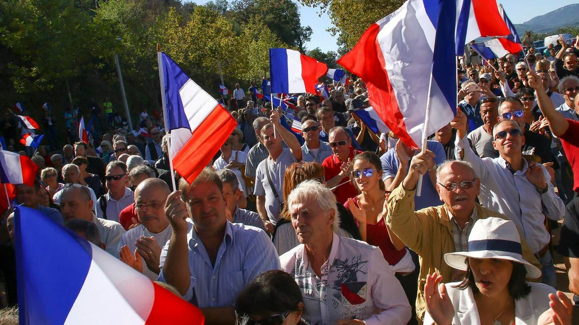 Supporters of far right National Front party attend a rally in Pierrefeu, southeastern France, Saturday, Oct. 8, 2016 (Photo: AP/Philippe Farjon)