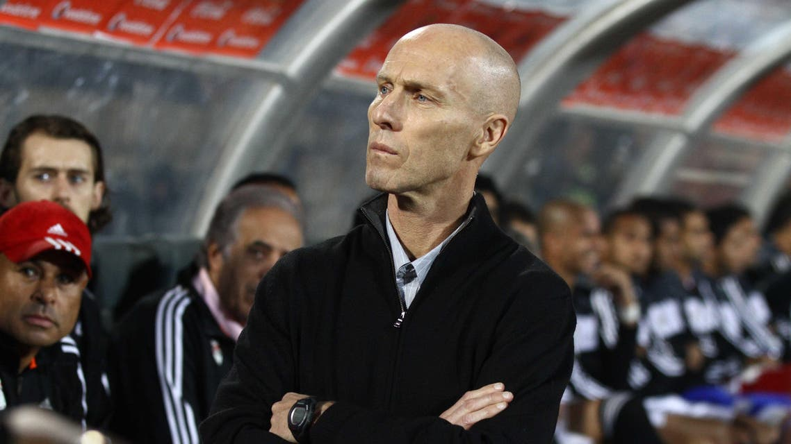 American Bob Bradley, the head coach of Egypt's national soccer team, watches during the World Cup qualifying playoff second leg soccer match between Ghana and Egypt, at the Air Defense Stadium in Cairo, Egypt, Tuesday, Nov. 19, 2013. (AP)