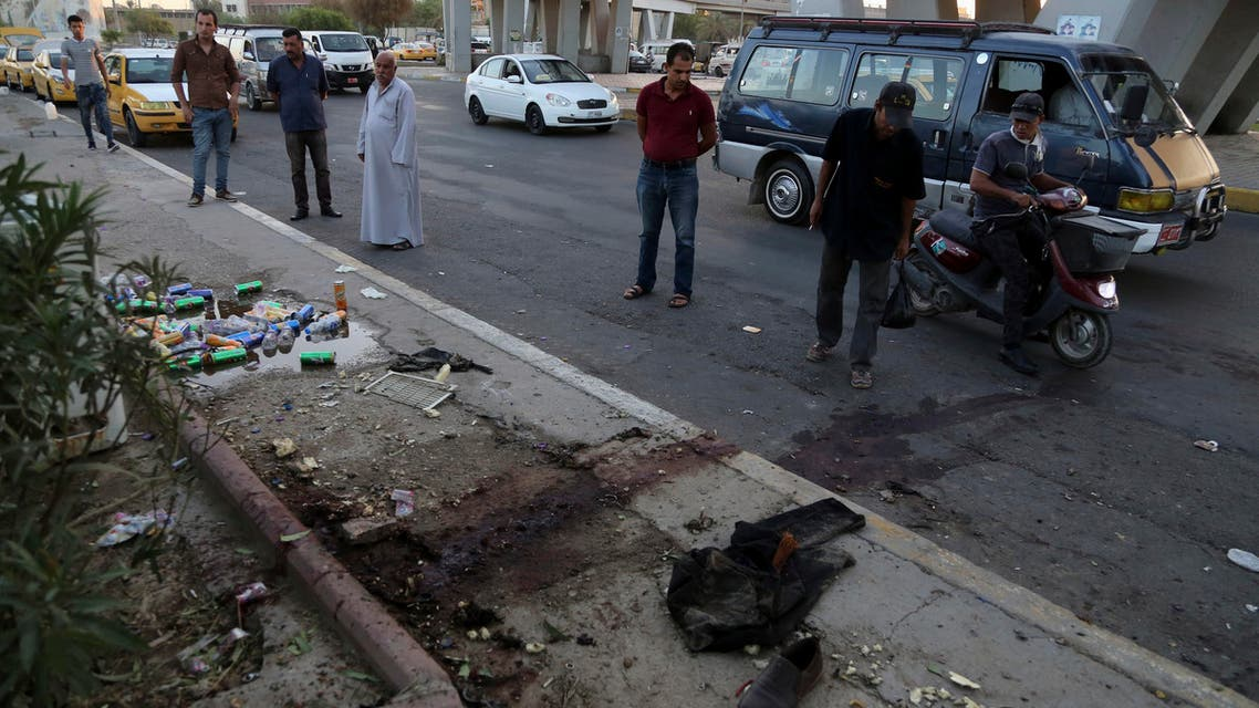 Drinks cans, items of clothing and blood are seen on the street as Iraqis inspect the aftermath of a late night suicide bombing, in Baghdad, Iraq, Sunday, Sept. 11, 2016. (File: AP)