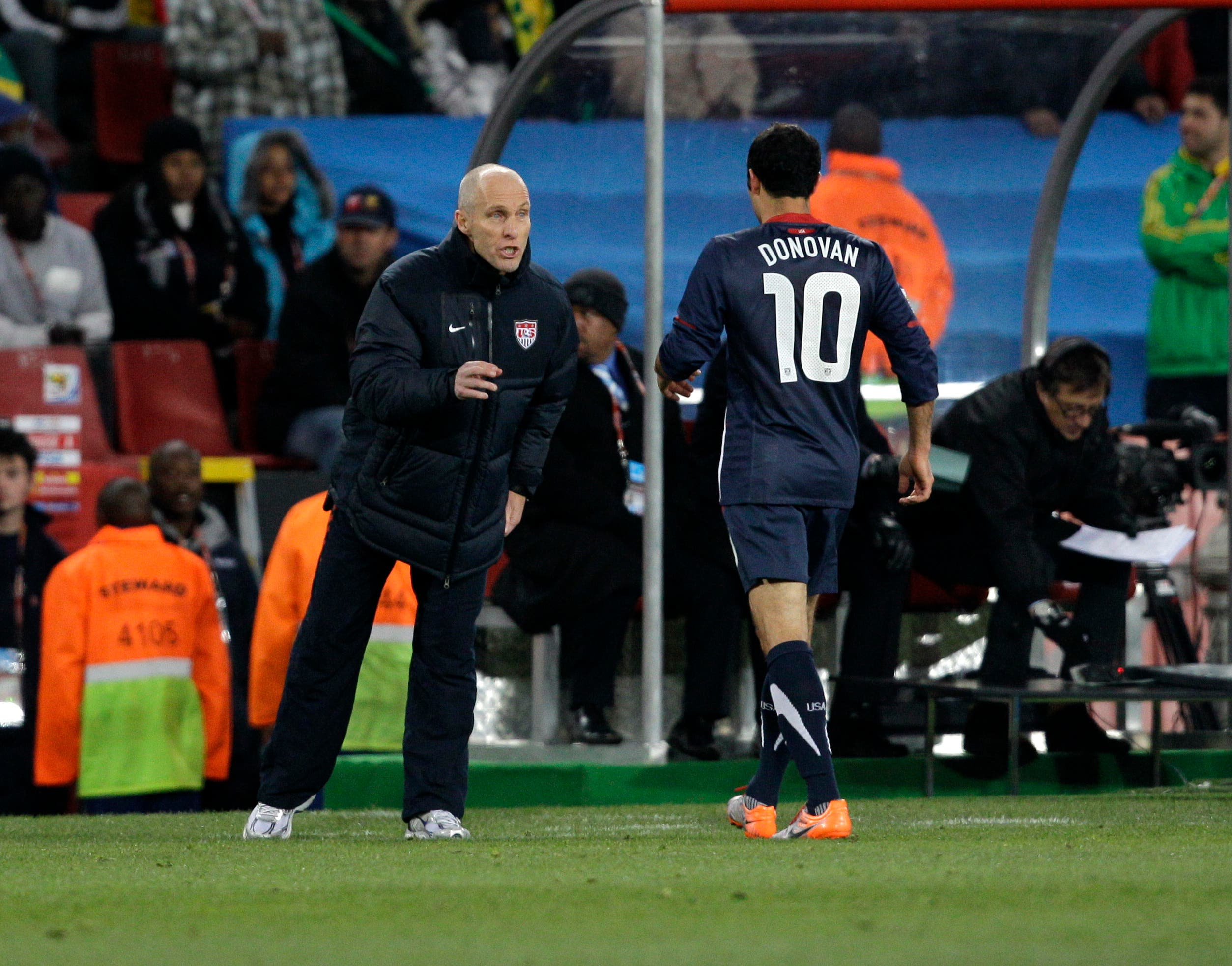 United States head coach Bob Bradley, left, speaks to United States' Landon Donovan during the World Cup group C soccer match between Slovenia and the United States at Ellis Park Stadium in Johannesburg, South Africa. (AP)