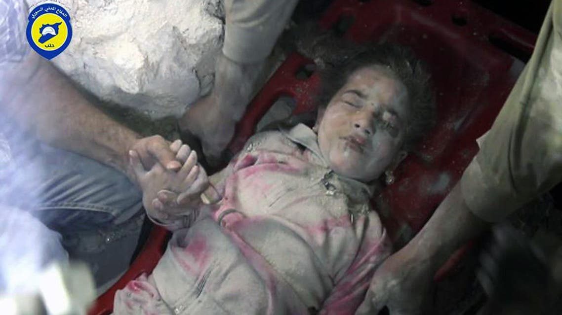 In this Wednesday, Sept. 28, 2016, photo provided by the Syrian Civil Defense group known as the White Helmets, shows survived child Ghazal Akhtarini, carried by Civil Defense workers from under the rubles after airstrikes hit al-Shaar neighborhood in Aleppo, Syria. AP