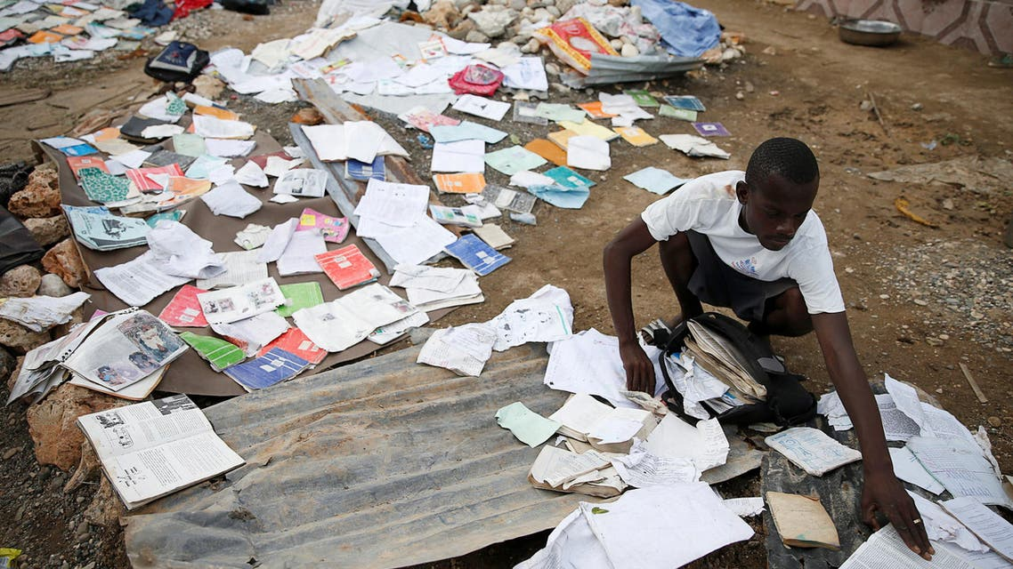 A man grabs papers from the floor after Hurricane Matthew passes Jeremie, Haiti, October 7, 2016. (Reuters)