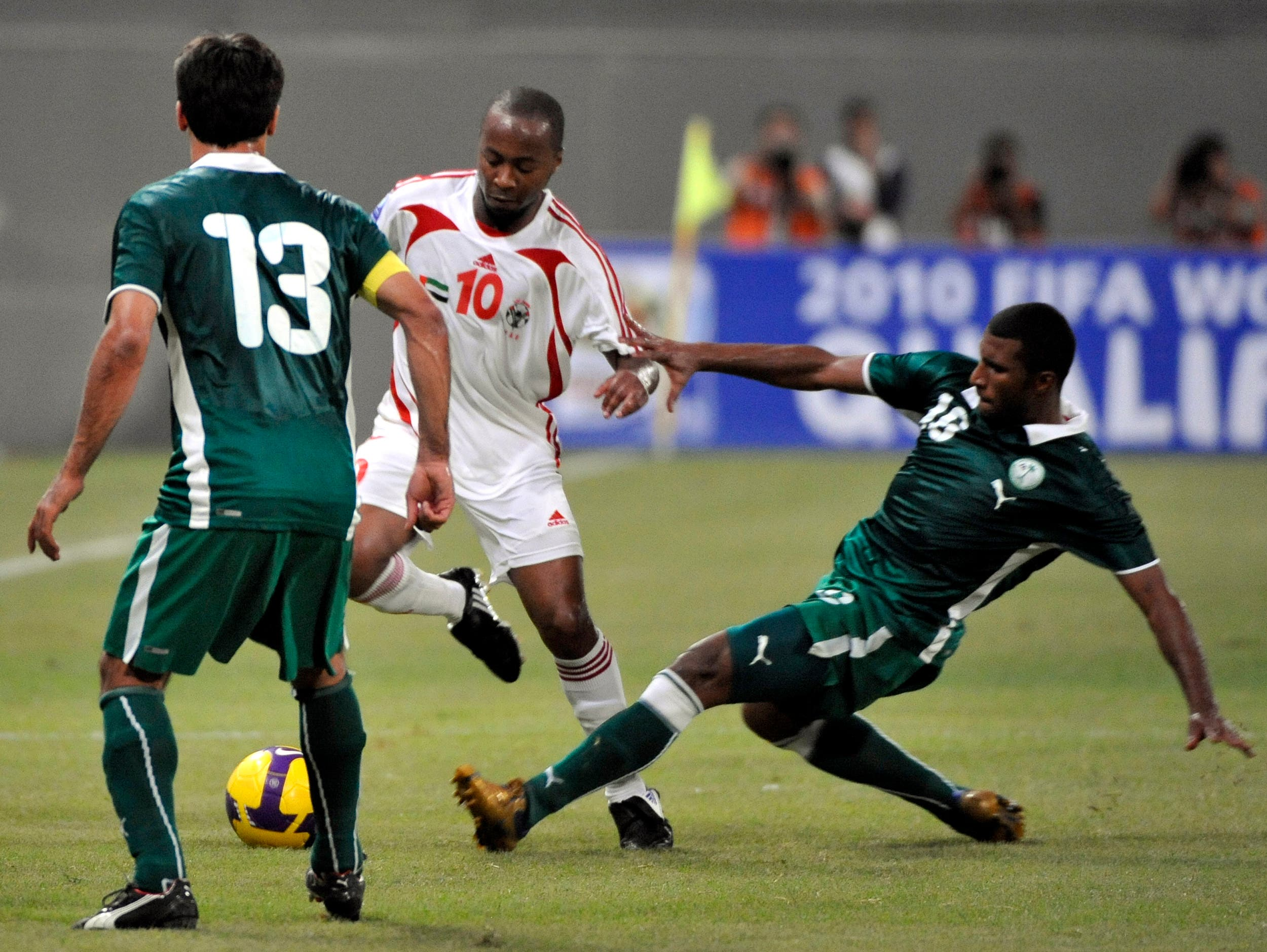 UAE's Ismaeil Matar, center, fights for the ball with Saudi' Arabia's Khaled Althaker, right, and Hussain Sulaimani during a World Cup Qualifying match in Abu Dhabi, United Arab Emirates, Wednesday, Sept. 10, 2008. (AP)
