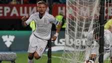 Italy wins late to keep pace with Spain in World Cup qualifying