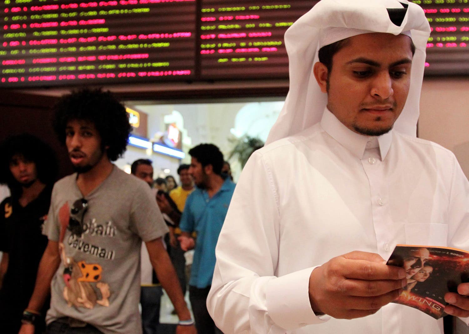 In this photo taken on May 7, 2009, Walid al-Musharraf, 27, of Riyadh, Saudi Arabia, looks at a brochure outside a Manama, Bahrain, movie theater. (File photo: AP)