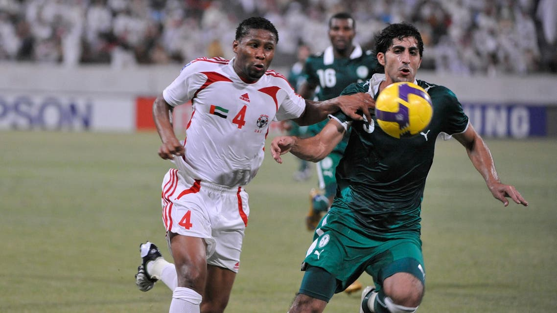 UAE's Subait Khater, left, fights for the ball with Saudi's Majed Alshalhoub during a World Cup Qualifying match in Abu Dhabi, United Arab Emirates, Wednesday Sept. 10, 2008. (AP)