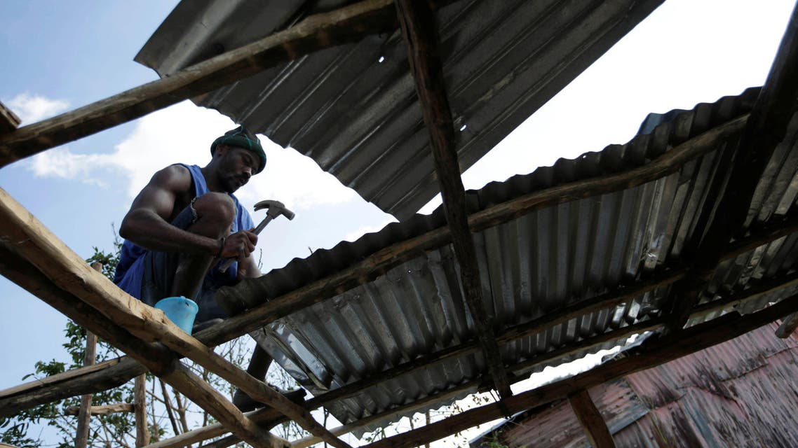 A man rebuilds his house after Hurricane Matthew passed in Camp Perrin, Haiti, October 8, 2016. (Reuters)