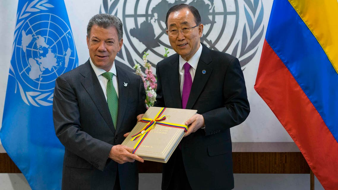 In this Sept. 19, 2016 file photo President Juan Manuel Santos of Colombia, left, presents a copy of a peace agreement that was forged in his country to United Nations Secretary-General Ban Ki-moon during a meeting at the United Nations headquarters. (AP)