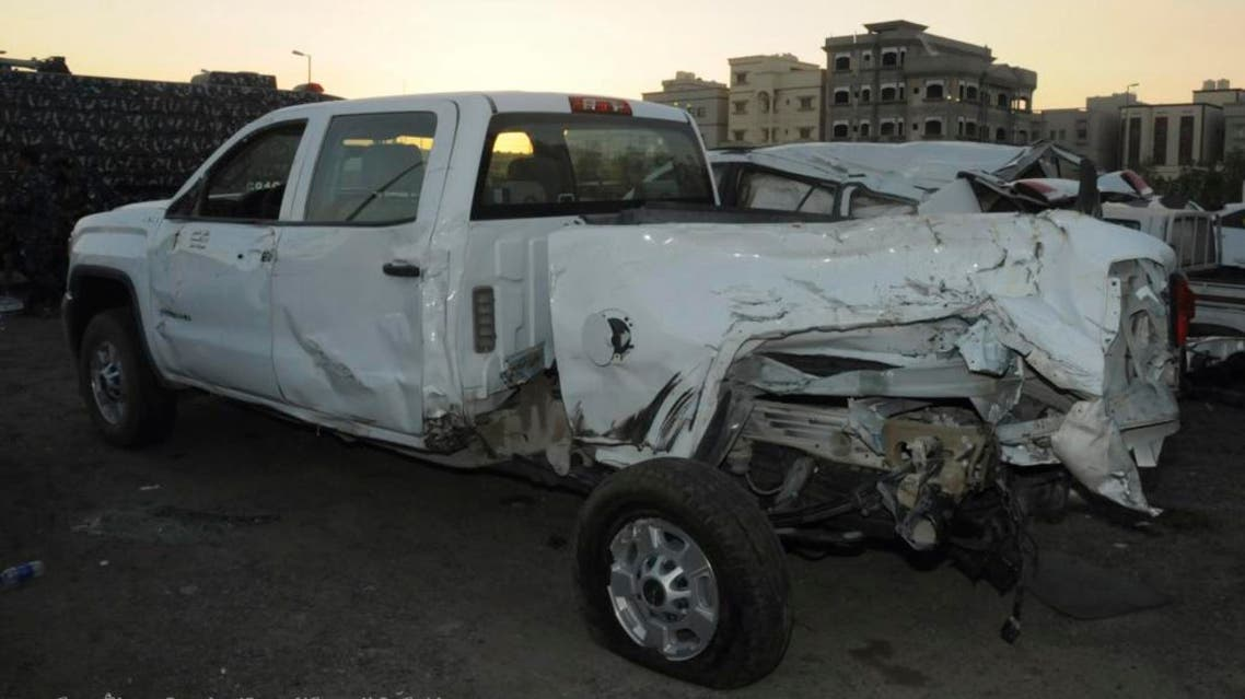 , a truck that carried five US soldiers is seen damaged after a garbage truck loaded with explosives and Islamic State papers rammed into it in Kuwait with only the Egyptian driver injured in the attack, authorities said. AP