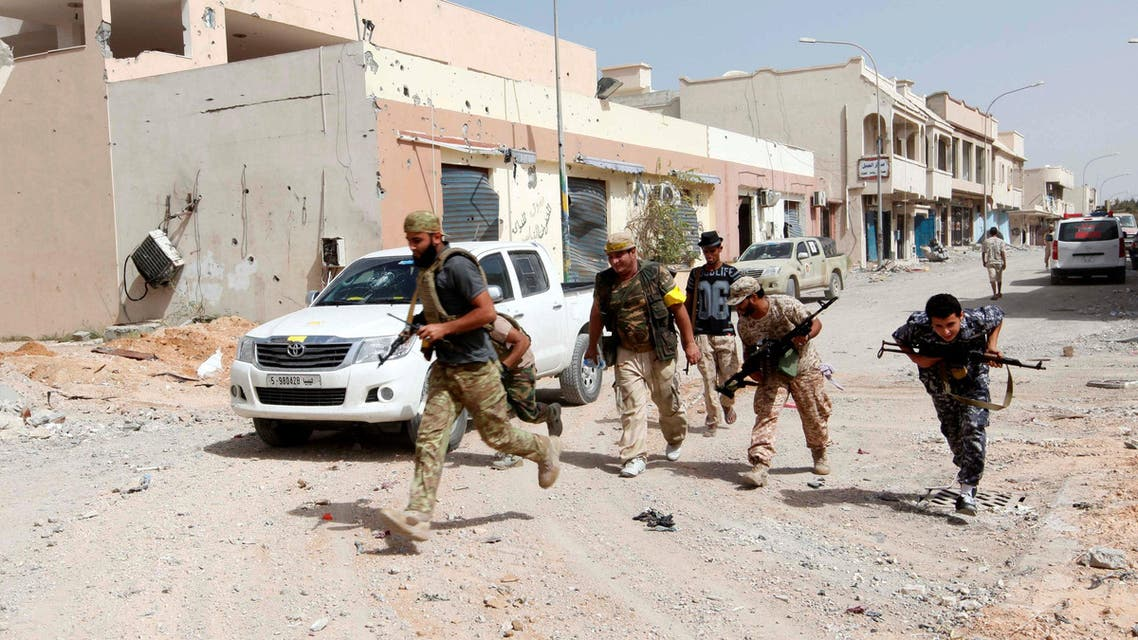 Fighters from Libyan forces allied with the U.N.-backed government run for cover during a battle with Islamic State militants in their remaining holdouts, in neighbourhood Number Three in Sirte, Libya, October 8, 2016. reuters